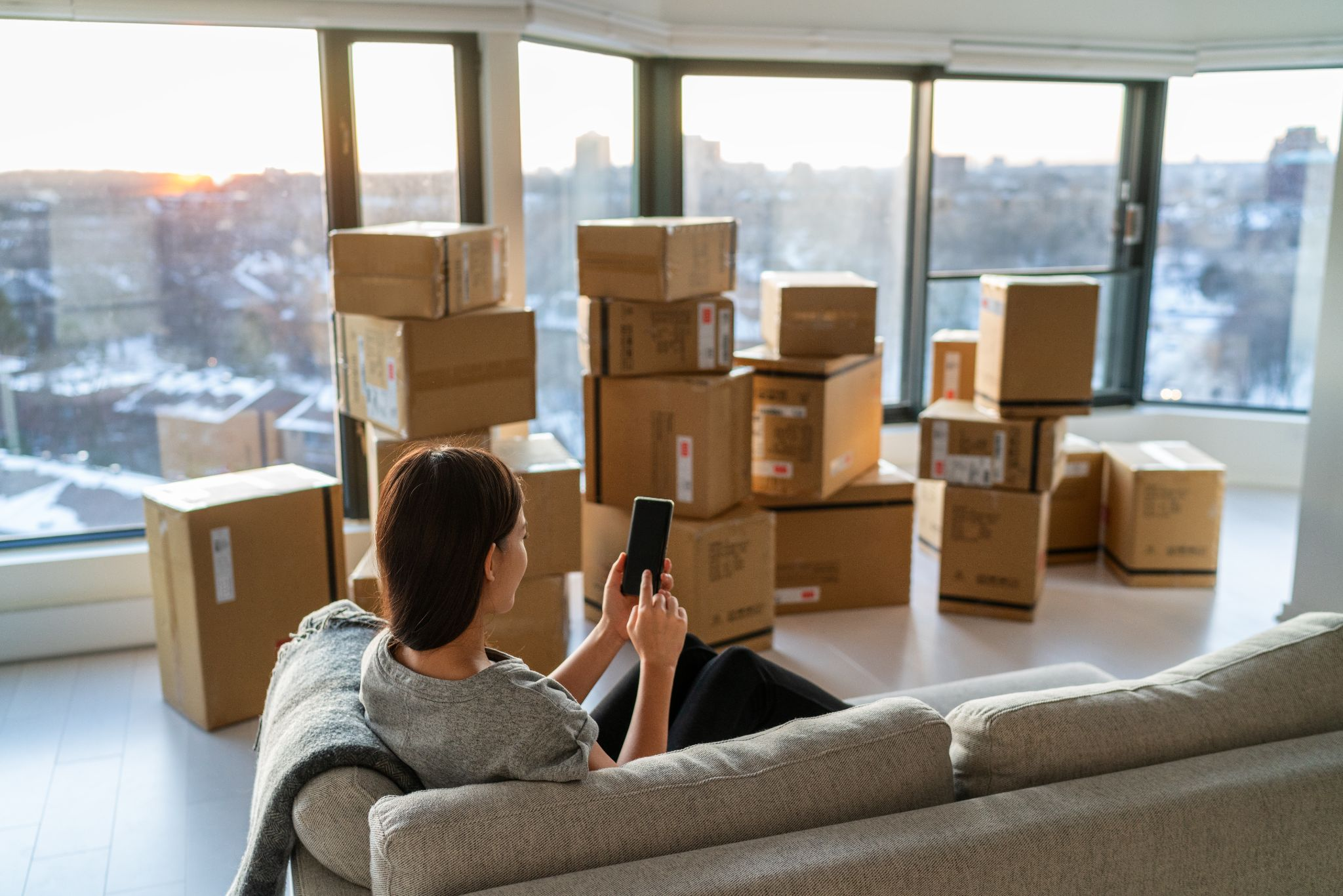 A woman relaxing even though she is moving because she already hired a full service moving company, such as Melendez Moving in Chicago, IL.