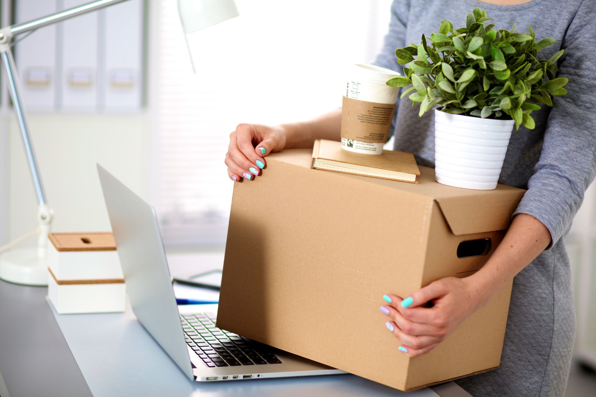 An office worker moving office, a process that can be made simple by a professional commercial and office moving company such as Melendez Moving in Chicago.